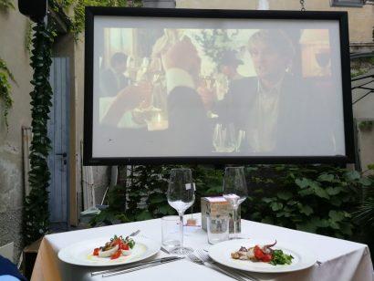 cena con film